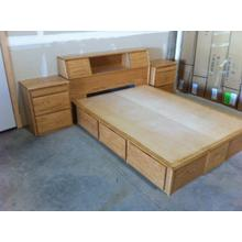 Contemporary Style Single High Queen Chestbed with Slant Headboard and Night Stands